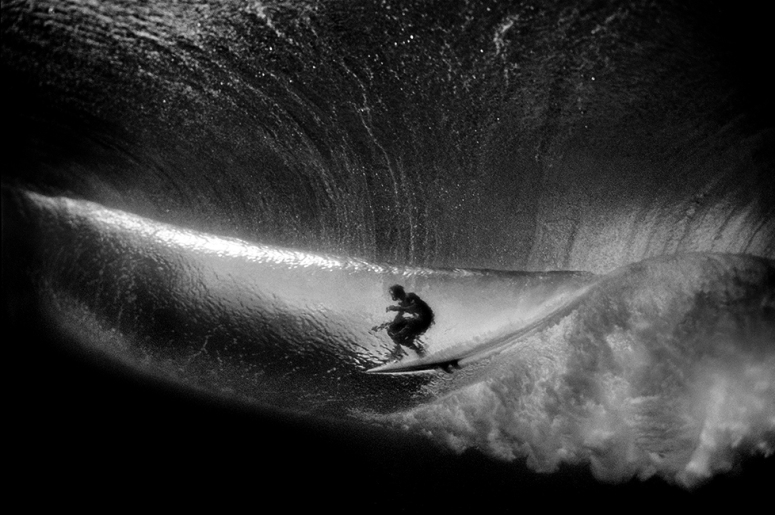 Surfer seen from underwater, by Aaron Chang